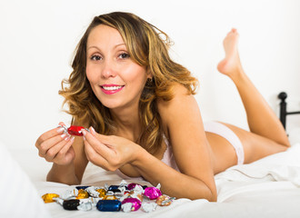 Woman eating candy in bed