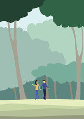 a man and a woman walking in the forest
