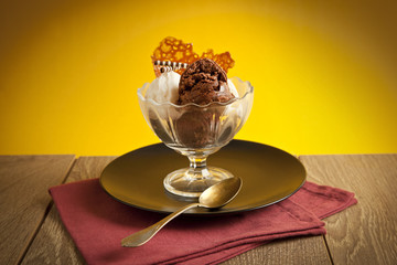 Ice cream in sundae cup on yellow background