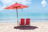Fototapety chairs and umbrella at Ponta Verde, Maceio, Alagoas, Brazil