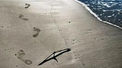 Footprints over seashore