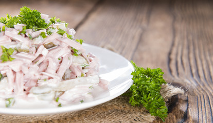 Meat salad (with mayonnaise) on a plate