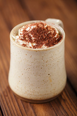 hot chocolat vintage mug, topping with cream and grated chocolat