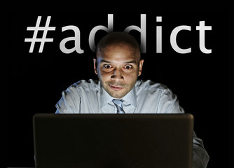 network addict man late night at computer internet addiction