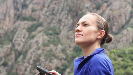 Portrait of a young woman tourist holding GPS navigator