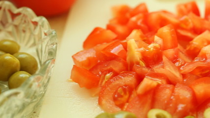 food background. closeup of slices of tomatos, and green olive