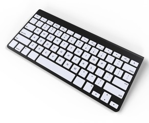 Black keyboard with white keys, top view.