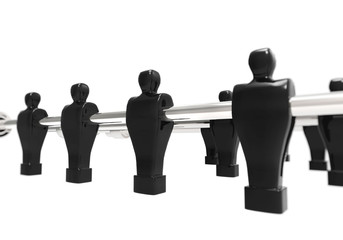 Black foosball figurines - isolated on white background.