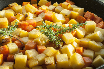 Thyme on diced vegetables
