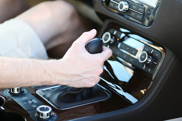 Man's hand on gearbox