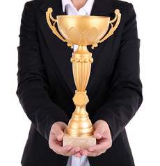 Woman holding trophy cup isolated on white
