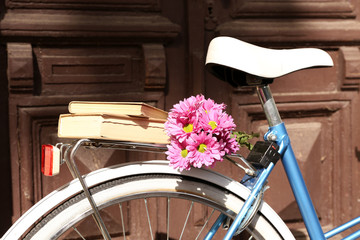 Old bicycle with flowers in metal basket
