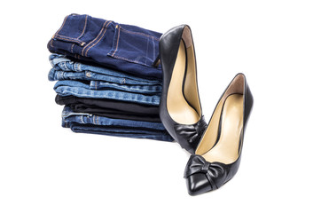 Stack of Jeans and a Pair of High Heel Shoes Isolated