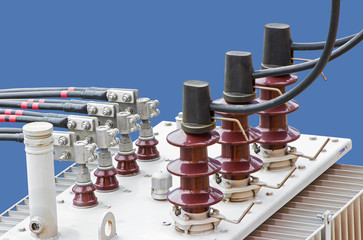 HV and LV Bushings of Transformer isolated on blue background
