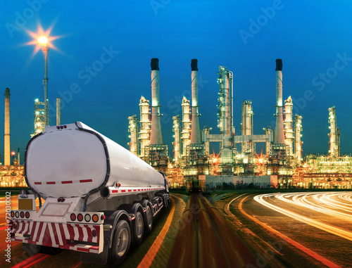 petroleum container truck and beautiful lighting of oil refinery