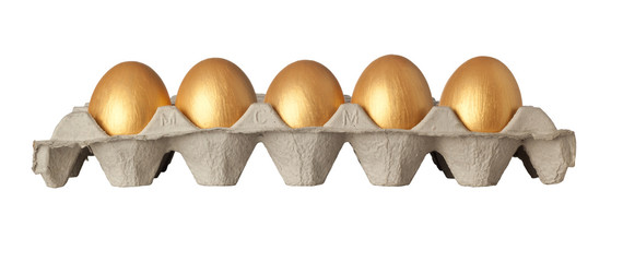Tray of golden eggs isolated on white background