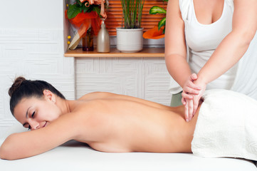 Young massage therapist giving a massage