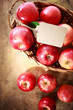 Red apples with a tag in a basket