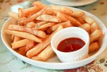 Freshly french fries with ketchup (tomato sauce)