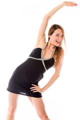 model isolated on plain background exercising stretching