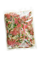 barbecue meat in vacuum marinade bag