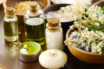 wooden bowl of color sea salt with ,candle ,massage oil