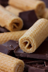 Wafer rolls with pieces of chocolate