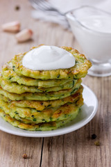 Pancakes with vegetable zucchini with sour cream, rustic style