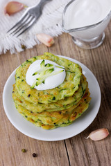 Pancakes with vegetable zucchini with sour cream