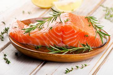 Raw salmon fillet on  cutting board