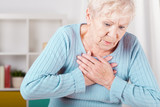 Elderly woman having heart attack