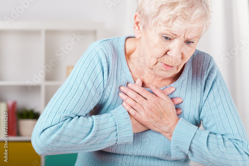 Fototapeta Elderly woman having heart attack