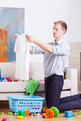 Young dad preparing laundry