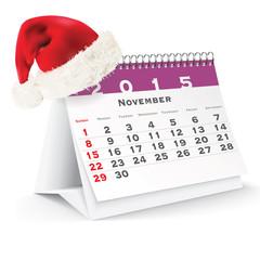 November 2015 desk calendar with Christmas hat