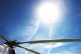 Air show. The plane climbs to the sun.