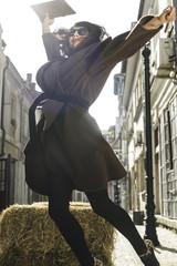 Girl jump on a street