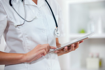 Female doctor using app on a tablet computer