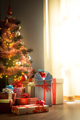 Traditional christmas tree with gifts