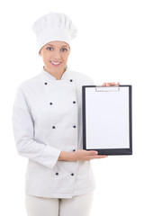 happy young woman in chef uniform holding clipboard with copy sp