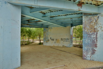 A decaying metal-and-concrete structure in an HDR shot