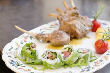 uramaki with lamb cutlet on serving dish