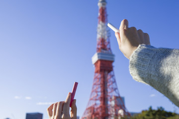 Hand draw the Tokyo Tower on blue sky
