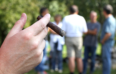 young smoker with fine cigar at school