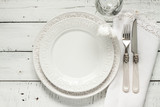 White table setting from above with elegant empty plate