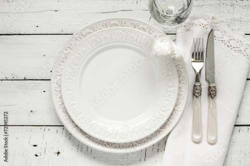 White table setting from above with elegant empty plate - 72045272