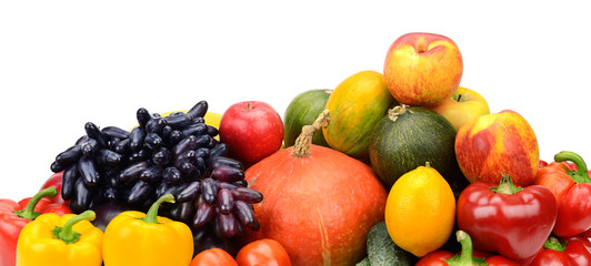 assortment of fresh fruits and vegetables on white