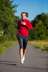 Urban leisure - woman running outdoor