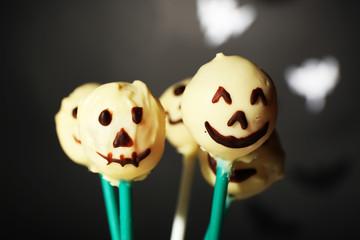 Funny Halloween cake pops on dark background