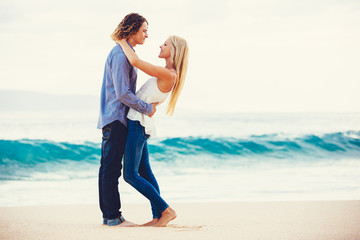 Young Couple Kissing on the Sea Shore