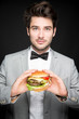 canvas print picture - Mann isst Burger